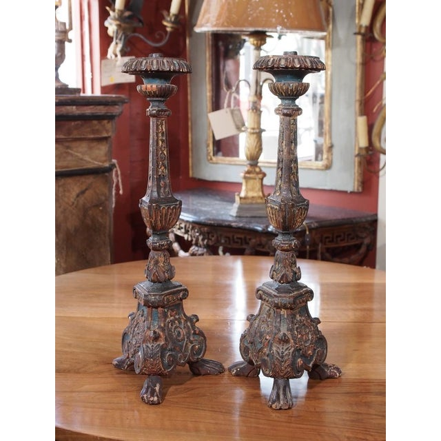 These gorgeous Italian altar sticks were converted into lamps. US wired. Tripod base with paw feet. The most favored...