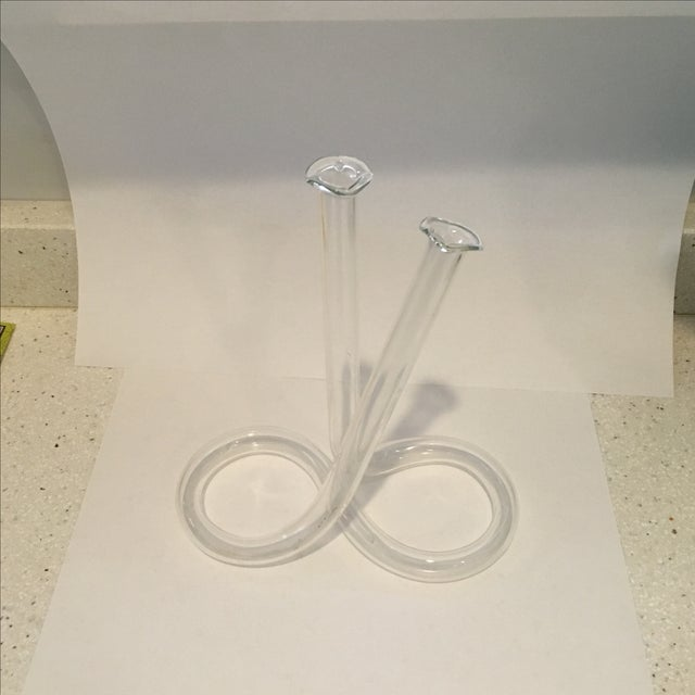 Unusual handblown glass vase with an infinity symbol-shaped base.