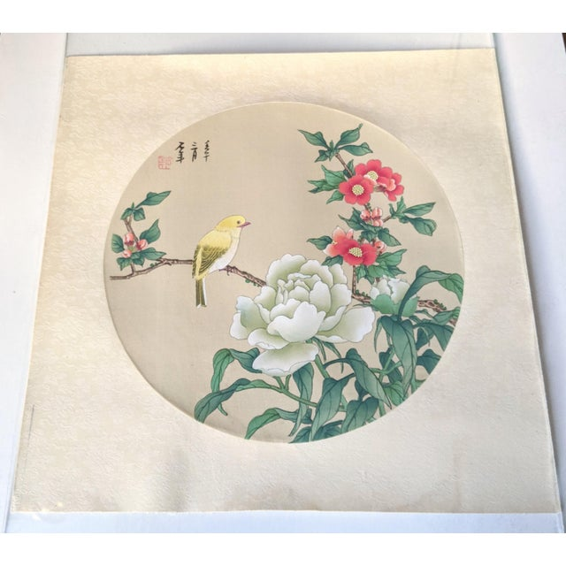 A beautiful example of Chinese artistry, depicting a mix of fauna and flora elegantly painted on a silk round. Artwork is...