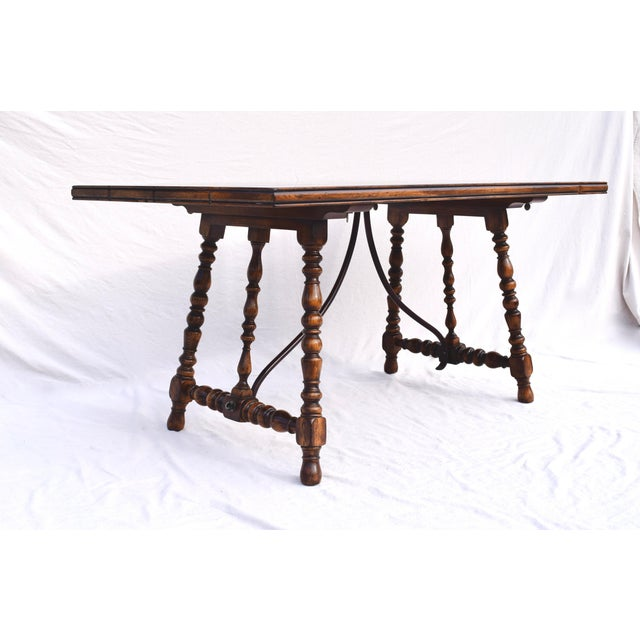 A Spanish Colonial style dining table purchased new by the original owners in the mid 2000's from ABC Carpet & Home Center...