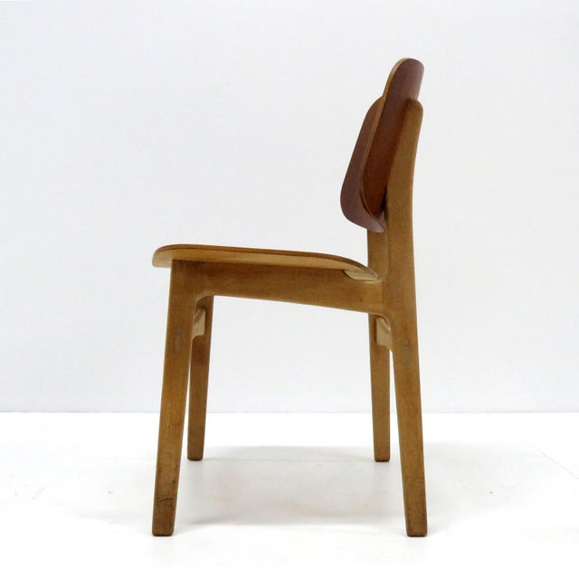 Wonderful set of 'Søborg' model 122 dining chairs by Børge Mogensen for Soborg Mobler with teak plywood shell seats and...