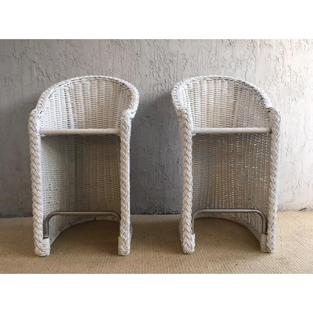 Great pair of woven rattan bar stools, chrome bar at the bottom, very comfortable, with back and arms.