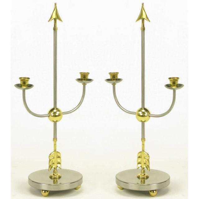 Pair of Italian empire style candelabra with center arrows and u shaped candle holders all intersecting a brass ball....