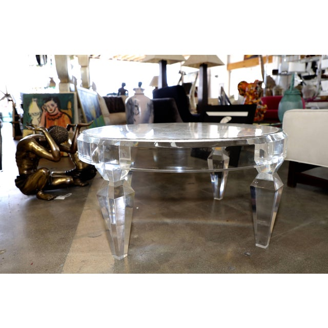 A nice Lucite and marble-top coffee table. It bears a CV sticker. Lucite has some marks and minor scratches. Marble...