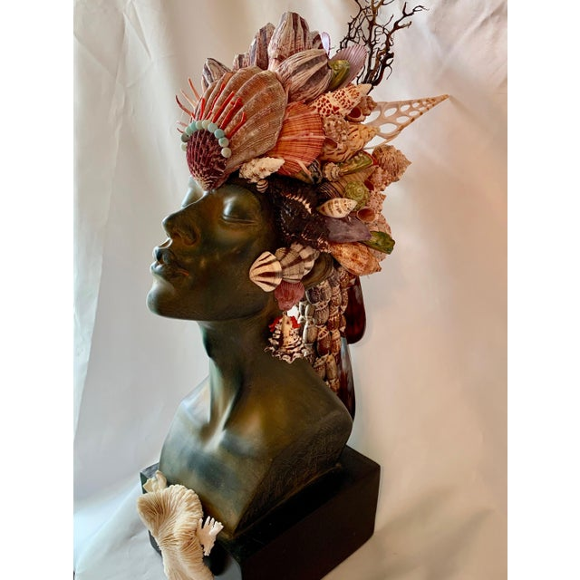 Number two in a limited edition of African busts decorated with rare seashells and Amazonite stones. the basal sculpture...
