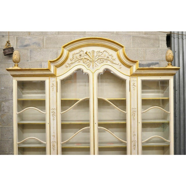 Large Italian Regency Cream and Gold Gilt Breakfront China Display Cabinet. Listing includes 2 piece construction, cream...