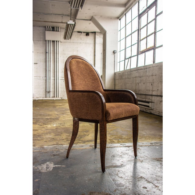 With its rich brown oak framing and herringbone upholstery, this armchair introduces a decidedly collegiate palette to a...
