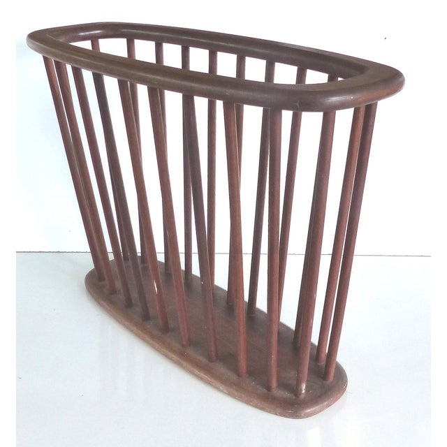 Offered for sale is a Teak spindle Danish Modern Wooden Magazine Rack/ Holder. The finish is original and there are a few...
