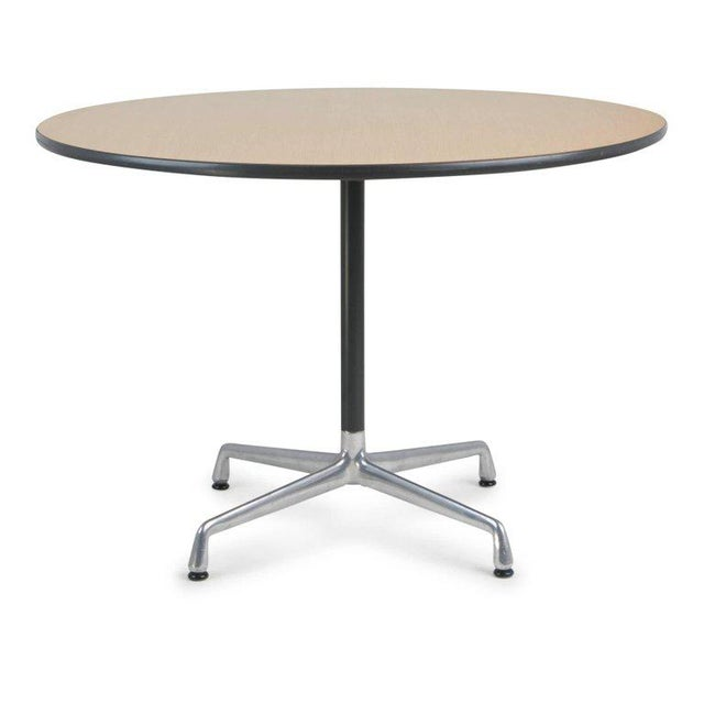 Herman Miller Aluminum Group dining or cafe table designed by Charles and Ray Eames, circa 1970. This minimalistic table...