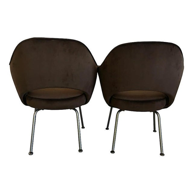 Pair of midcentury executive armchairs by Eero Saarinen for Knoll. Newly upholstered in a sophisticated chocolate brown...