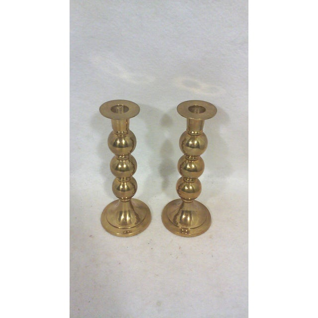 Modernist triple brass sphere candle holders in a stacked shape with flared bobeche style rims. These Mid-Century...