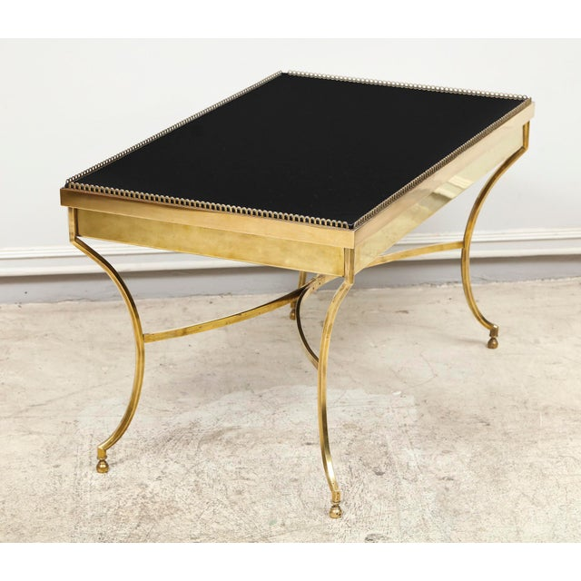 Whimsical brass coffee table with smoked glass and galleried top.