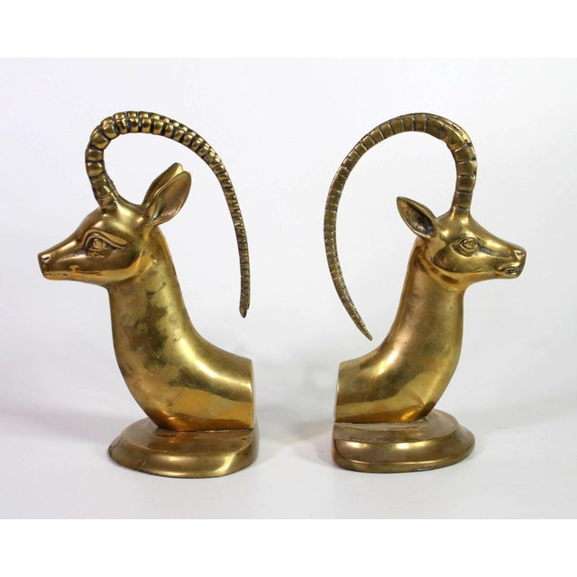 Brass pair of bookends from the Hollywood Regency era of the 1960's when exotic animals, gaudy gold and brass figurines,...