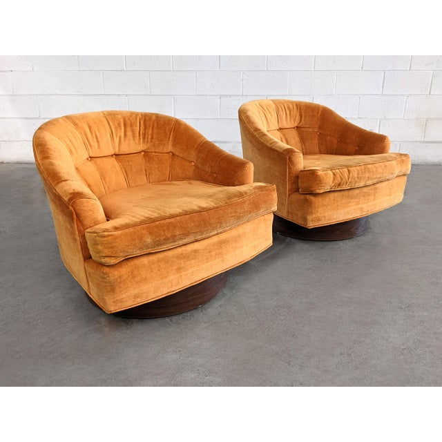 Pair of Mid Century Modern swivel chairs, in the style of Milo Baughman. The chairs are all original condition.