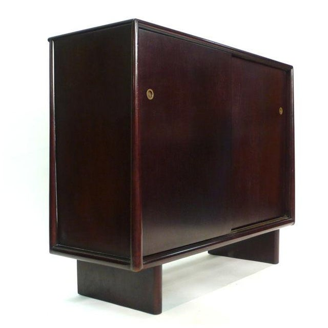 A dark and richly finished mahogany cabinet with 13 contrasting birch interior utility drawers. All sides are finished...