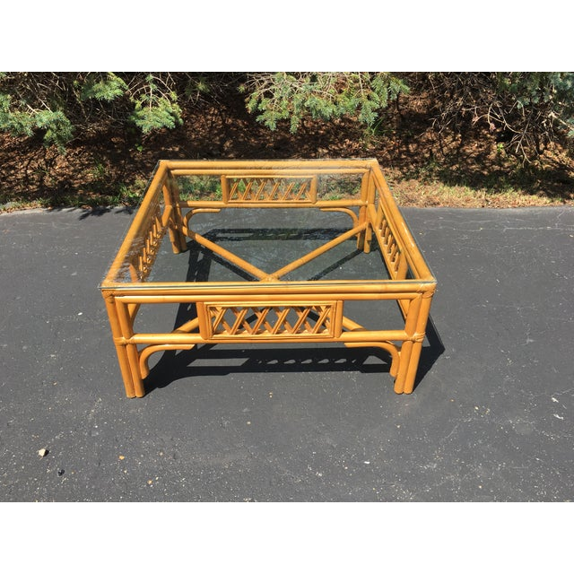 """Mid-Century square glass top Rattan table measuring 32"""" x 32"""" x 15.5"""" high."""