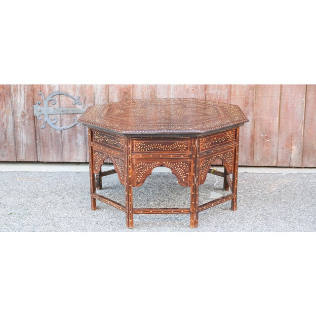 Anglo-Indian rosewood bone inlay octagonal side table, stands on shaped legs accented with intricately inlaid arch panels...