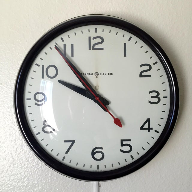 Materials: Bakelite, metal, glass This is a high quality original electric (corded) wall clock. Keeps time perfectly! Easy...