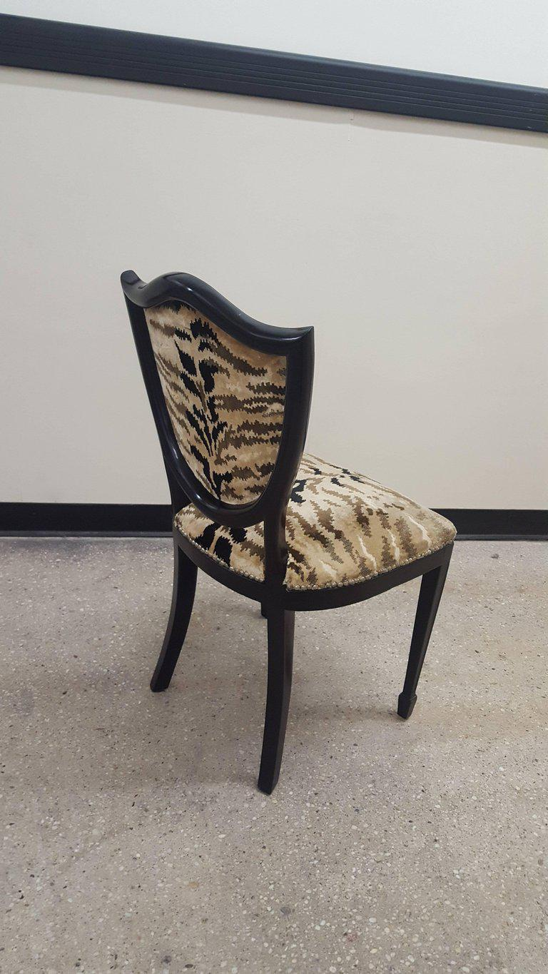 Set Of Four Ebonized Shield Back Chairs Upholstered In Leopard Fabric.