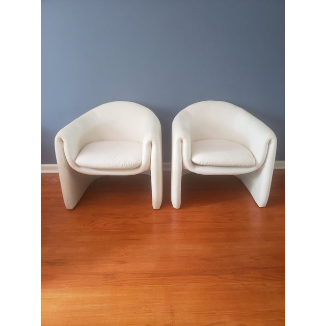 Barrel arm chairs by iconic designer Vladimir Kagan. for Preview. Sculptural minimalism that is both chic and comfortable....