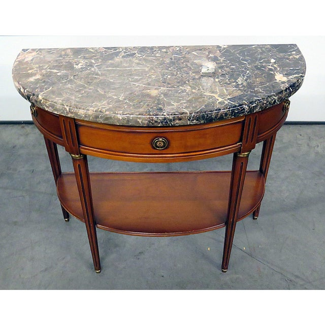 Directoire style marble top 1 drawer demi-lune console table with brass accents.