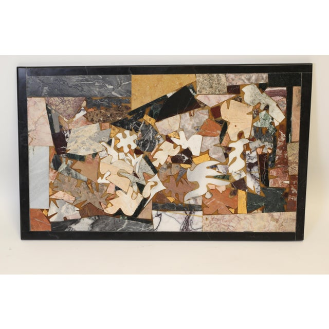 This is a great inlaid piece of marble that could be used in different ways. An abstract design is created with various...