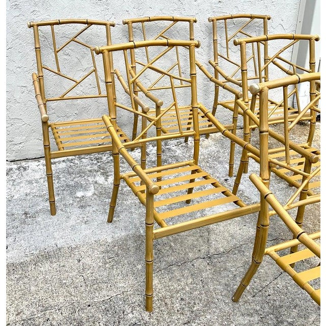 Set of six Hollywood Regency faux bamboo garden chairs, each one realistically cast and painted aluminum, with sturdy...