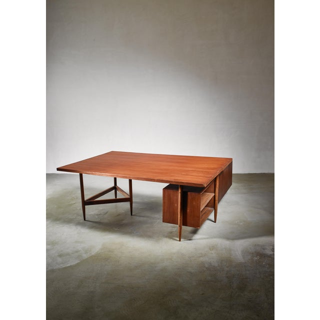 A demountable, large teak desk with a shelving unit from the Chandigarh High Court, by Pierre Jeanneret. The measurements...