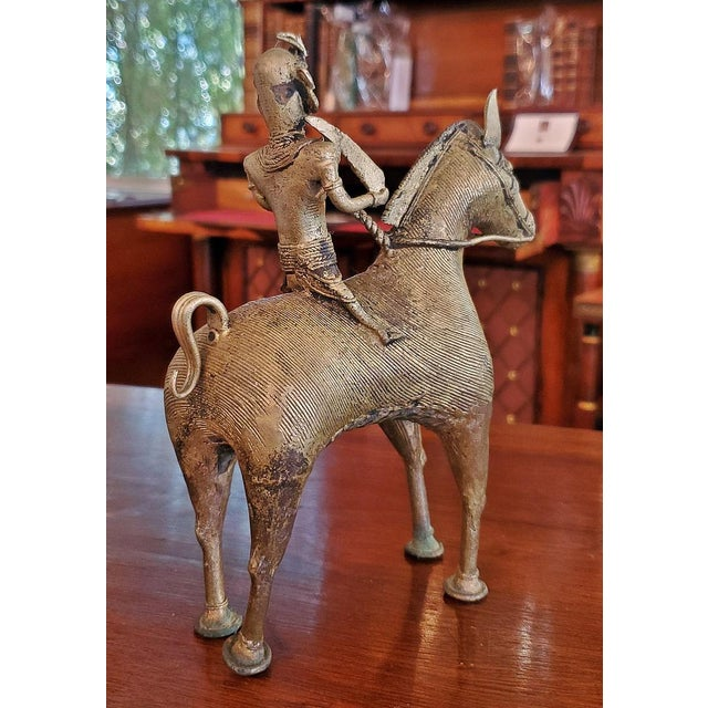 Presenting a lovely Antique Indian Dhokra Horse and Rider Sculpture. Probably from the late 19th or Early 20th Century as...