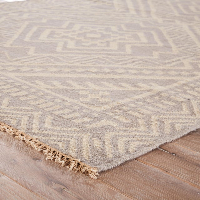 This global-inspired flatweave area rug boasts a captivating graphic pattern, recalling angular southeast Asian motifs. A...