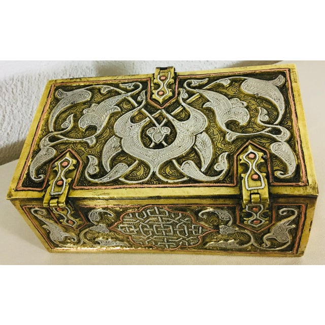 This is a 19th-century hand hammered Moorish style dresser box, hand chafed in steel and brass with a turn hasp on the...
