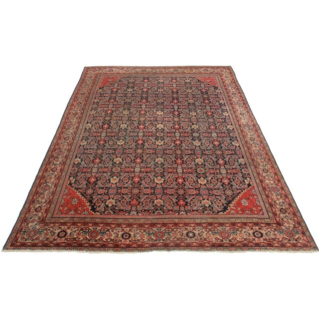 Perfect for adding a luxe, boho vibe to a room, this is an antique Persian Mahal made of hand-knotted wool.