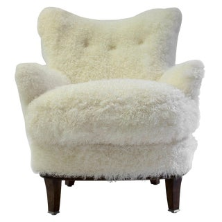 Shearling Covered Shaped Back Chair With Wood Base and Legs With Metal Cap Feet For Sale