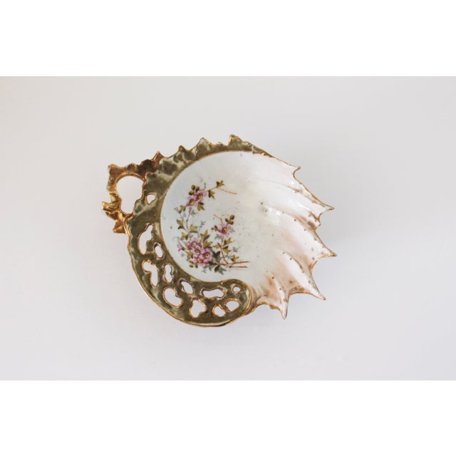 Beautiful vintage ring dish sourced from the flea market. Gold painted scalloped edge on one half and spiked edges on the...