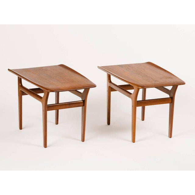 Pair of teak Mid-Century Modern end tables with streamline design. Fabulous sleek angles throughout, with tapered leg...