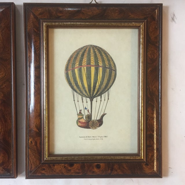 Pair of fun hot air ballon prints in burned wood frames circa 1960's 5 x 7 each overall size with vintage original frames...