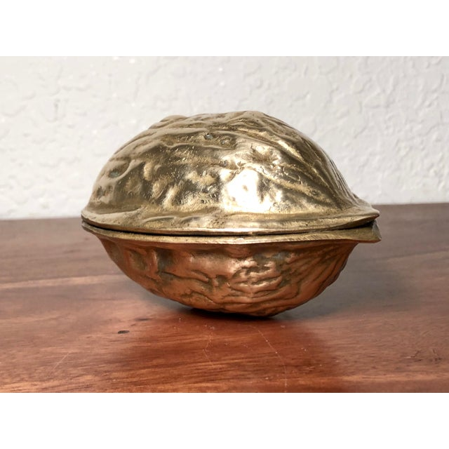 This vintage solid brass walnut shucker makes nut cracking great again. As it cracks your walnuts, it catches the...