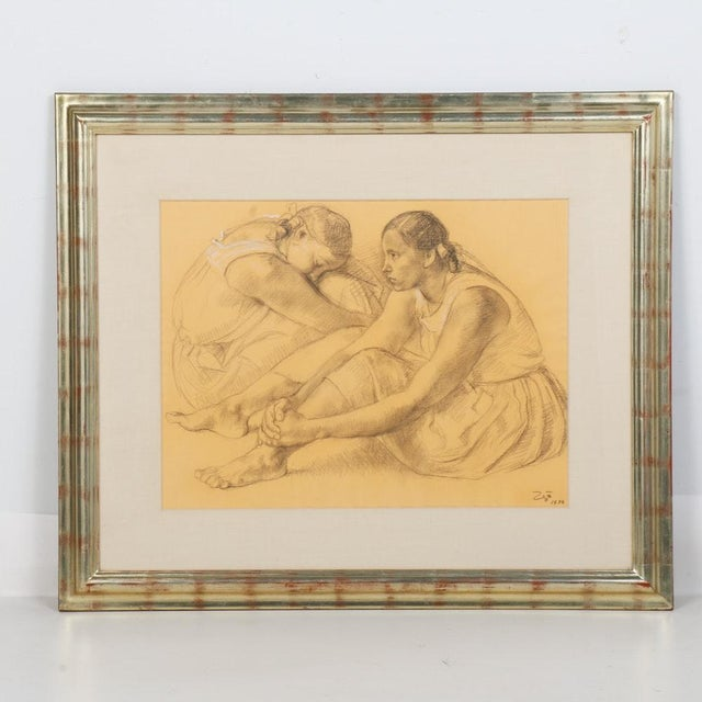 A Francisco Zuñiga (1912-1998) signed charcoal figure drawing on paper. Depicting two seated women, this charcoal with...