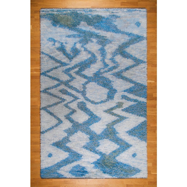 Large Swedish knotted carpet with rya technique, Sweden, circa 1950s. Signed {EN}. Handwoven wool in blue and green hues....