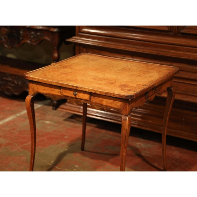 Crafted in France circa 1820, the elegant card table is square in shape; it sits on four cabriole legs and features a...