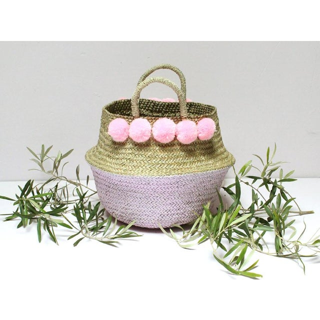 Beautiful double woven belly basket with lovely pastel pink pom poms, half dipped in pastel pink paint color. Our double...