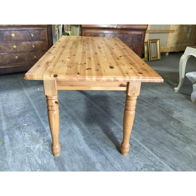 Vintage French pine farm table form the Brittany region of France. This table is in very fine condition with interesting...