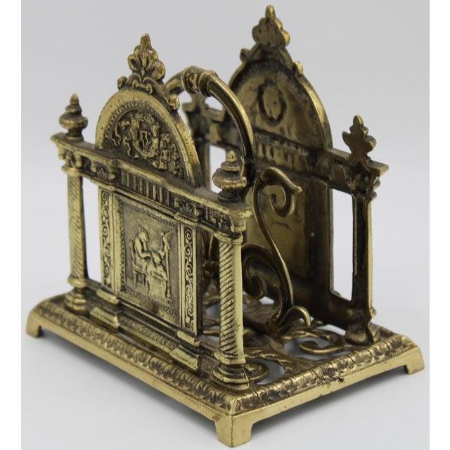 A Renaissance Revival, circa 1900 solid brass cast letter rack. It has a wonderful pierced design with columns, scrolls,...