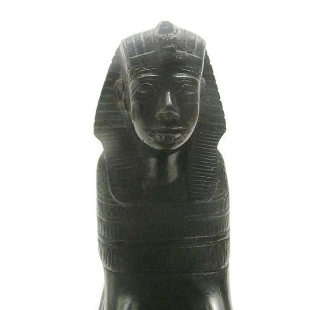 This sculpture is carved from beautiful black marble. The sphinx has intricate details carved into his its headdress and...