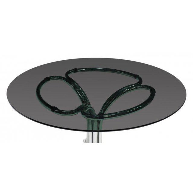 Italian modern glass top dining table circa 1970, in the manner of Bertoia. Featuring a circular tinted glass top, resting...
