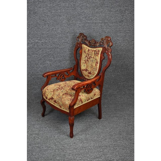 This Chair Features an Ornate Shield Back which is enhanced with scroll leaf carvings and a decorative wood back splat....