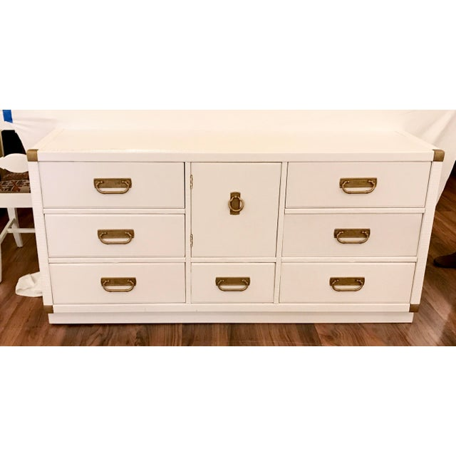 A gorgeous credenza with campaign style corner hardware and faux bamboo style pulls made by Drexel has been newly...
