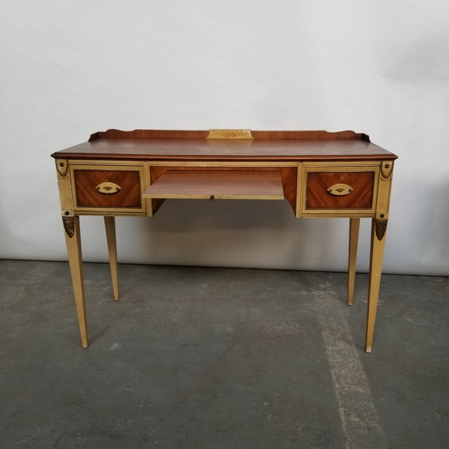 Gorgeous and rare Flint & Horner French deco style writing desk. The desk has two dovetailed drawers and slide out shelf....