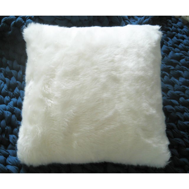 Cuddle up with this faux Arctic fox pillow from Romo, UK! Backed in chenille, with invisible zipper.