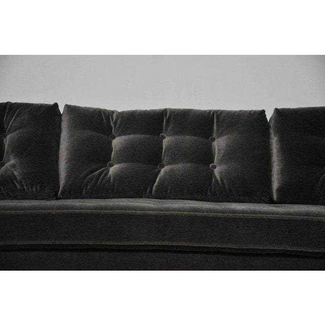 We are proud to offer this opulent curved sofa by Harvey Probber. Reupholstered in charcoal mohair.